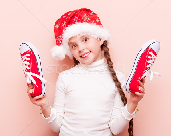 irl with gumshoes and Santa Claus hat  Stock photo © Massonforstock