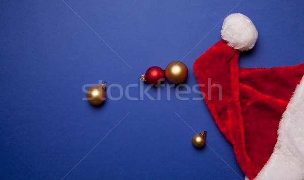 Santa Claus hat and christmas baubles Stock photo © Massonforstock