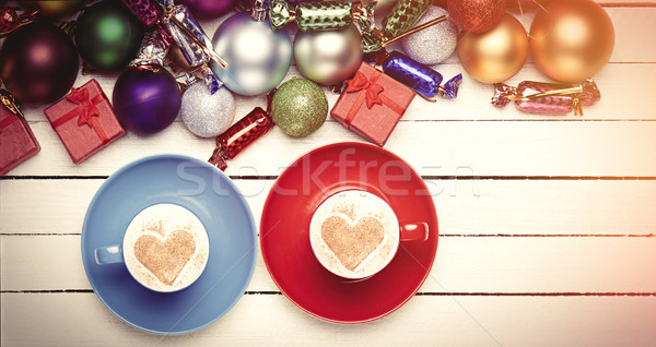 Two cups of coffee and christmas gifts.  Stock photo © Massonforstock