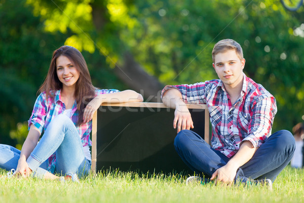 Young teen couple with blackboard  Stock photo © Massonforstock