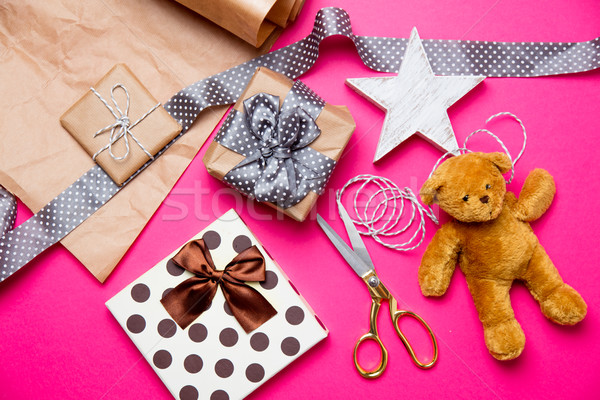 Stock photo: cute gifts, star shaped toy, teddy bear and things for wrapping