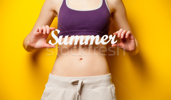 photo of perfect slim female body with tablet  in the hands on t Stock photo © Massonforstock