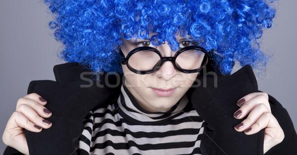 Funny fashion blue-hair girl in glasses and black coat.  Stock photo © Massonforstock