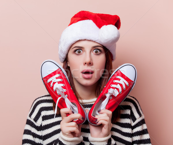 woman with gumshoes Stock photo © Massonforstock