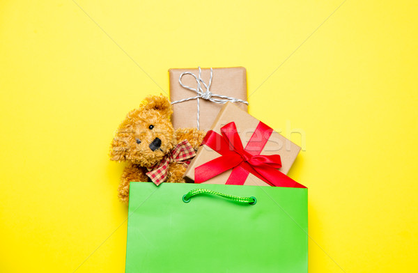 cute gifts in beautiful green shopping bag and teddy bear on won Stock photo © Massonforstock