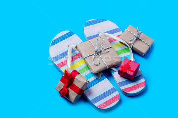 colorful sandals and cute gifts on the wonderful blue background Stock photo © Massonforstock