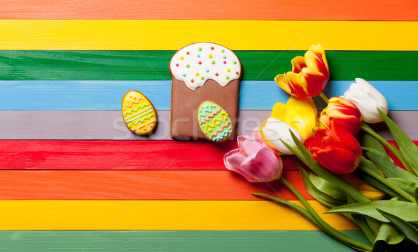 bunch of tulips, eggs shaped cookies and glazed cake on the wond Stock photo © Massonforstock