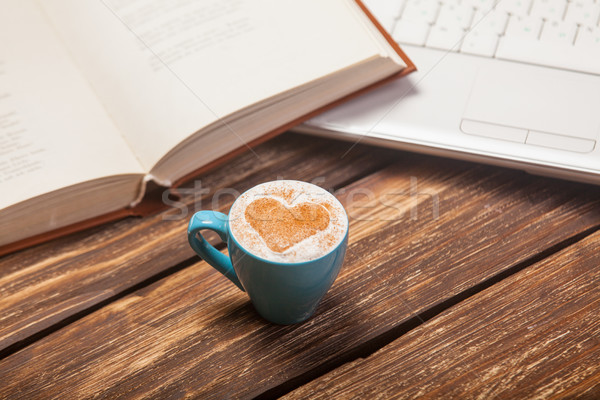 photo of beautiful cup of coffee, notebook and laptop on the won Stock photo © Massonforstock