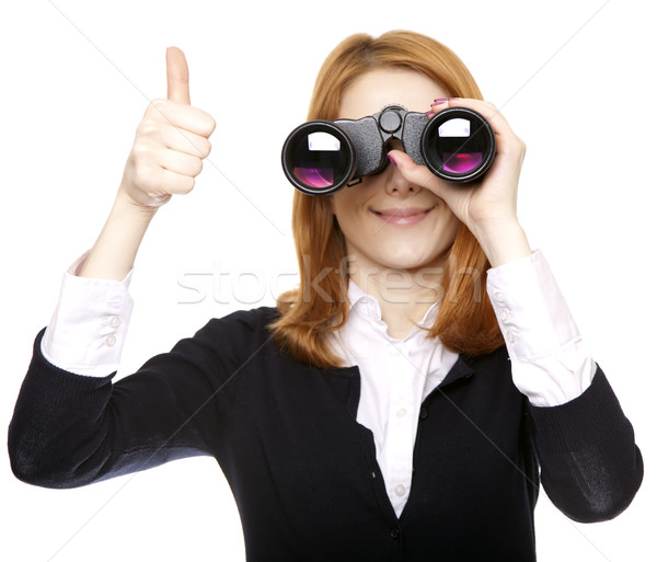 Business women seeking with binocular and show OK symbol. Studio shot. Stock photo © Massonforstock