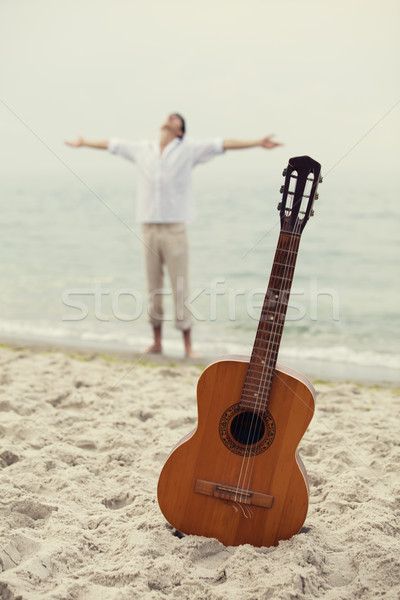 Men at the beach and guitar. Stock photo © Massonforstock