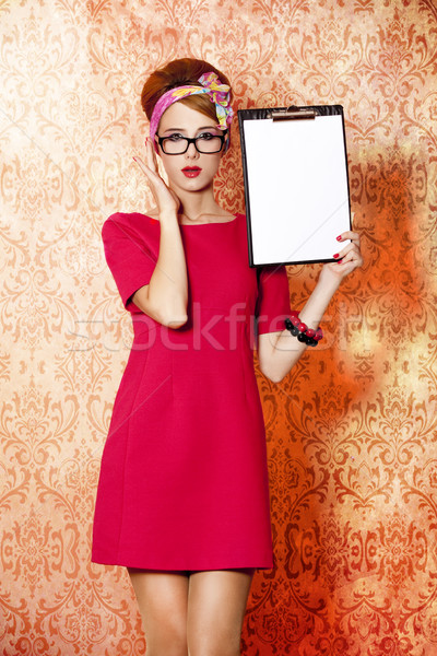 Style redhead girl in glasses and board at pink background. Stock photo © Massonforstock