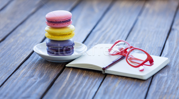 Macarons and little notebook with glasses  Stock photo © Massonforstock
