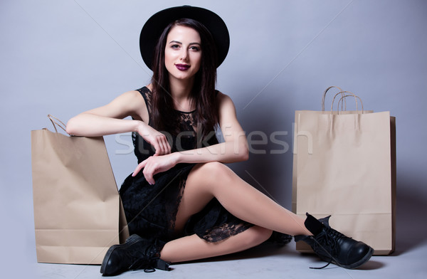 beautiful young woman with shopping bags sitting in front of won Stock photo © Massonforstock