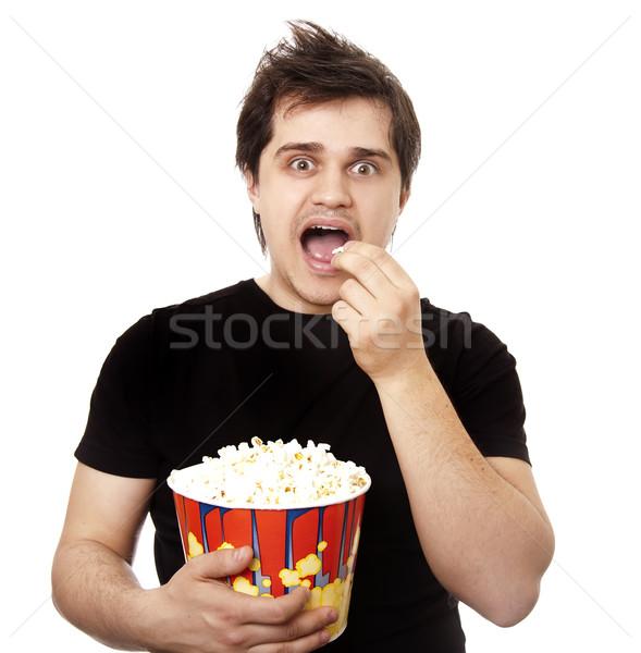Funny men eating popcorn.  Stock photo © Massonforstock
