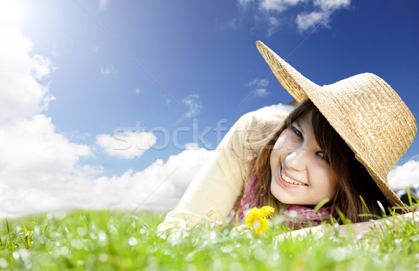 Beautiful brunette girl in hat at meadow. Stock photo © Massonforstock
