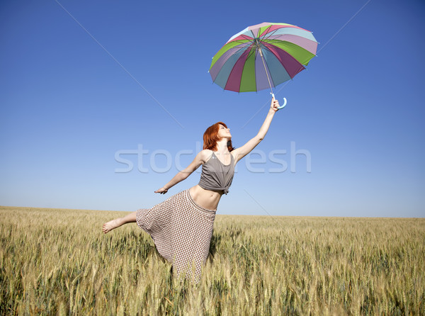 Stock photo: Girl with umbrella at field