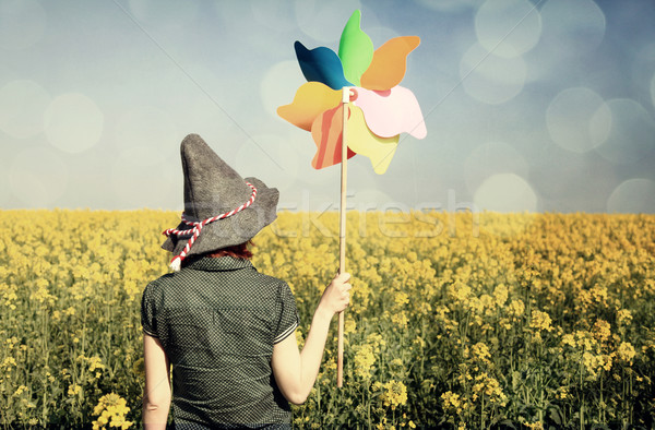 Girl with wind turbine at rapeseed field Stock photo © Massonforstock