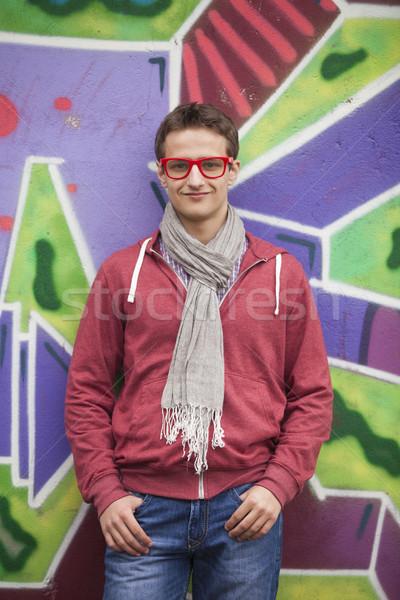 Style teen boy near graffiti background. Stock photo © Massonforstock