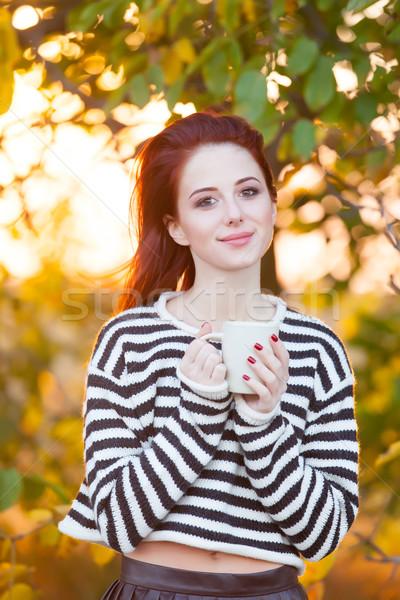 Mujer taza té café aire libre otono Foto stock © Massonforstock