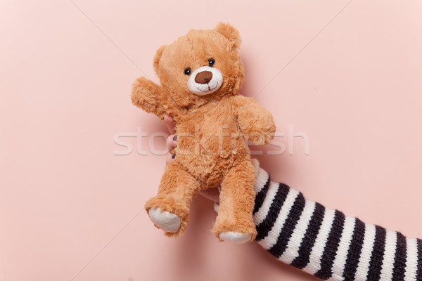 Hand holding teddy bear Stock photo © Massonforstock