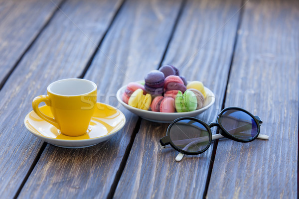 Cup of coffee and macarons with sunglasses  Stock photo © Massonforstock