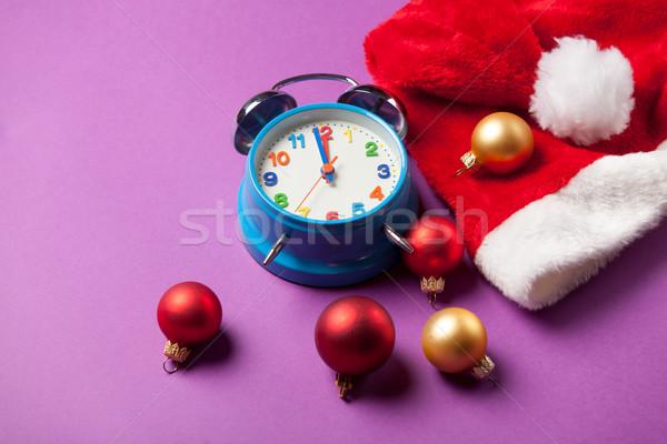 Christmas alarm clock and Santas hat  Stock photo © Massonforstock