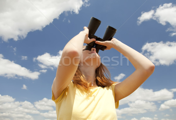 Girl with binocular watching in sky. Stock photo © Massonforstock