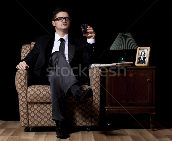 Man with alcohol sitting in vintage armchair Stock photo © Massonforstock