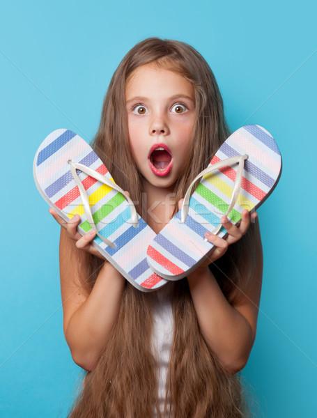 Fiatal meglepődött lány papucs kék nő Stock fotó © Massonforstock