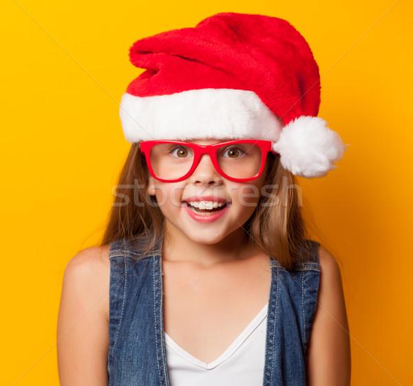 girl in red glasses and Santas  Stock photo © Massonforstock