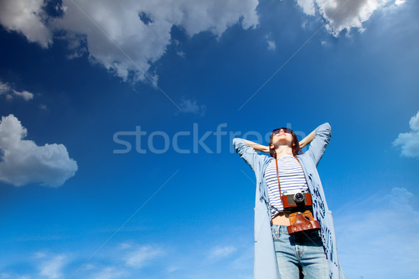 beautiful young woman with her retro camera onthe wonderful sky  Stock photo © Massonforstock