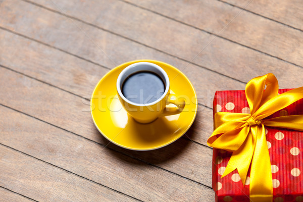photo of cup of coffee and cute wrapped gift on the wonderful br Stock photo © Massonforstock