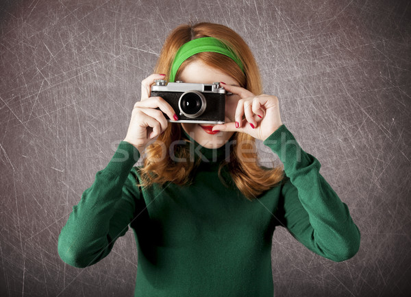 American redhead girl with camera.  Stock photo © Massonforstock
