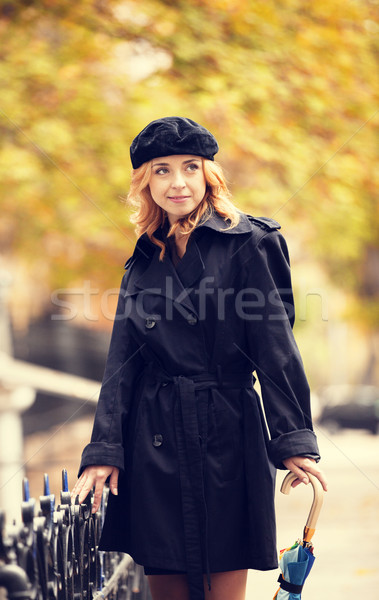 Single girl with umbrella at the street. Stock photo © Massonforstock