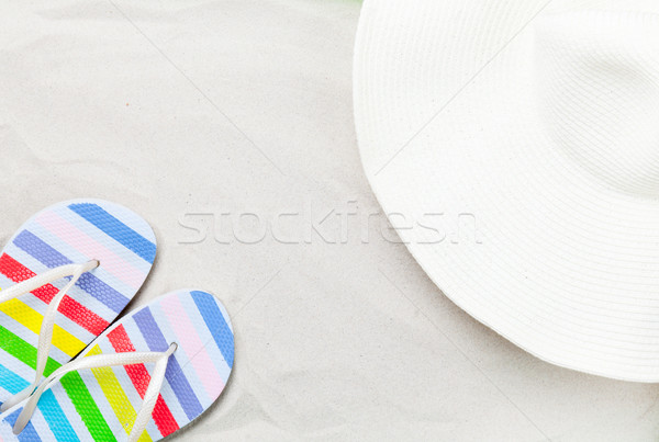 Colorful flip flops and classic beach hat  Stock photo © Massonforstock