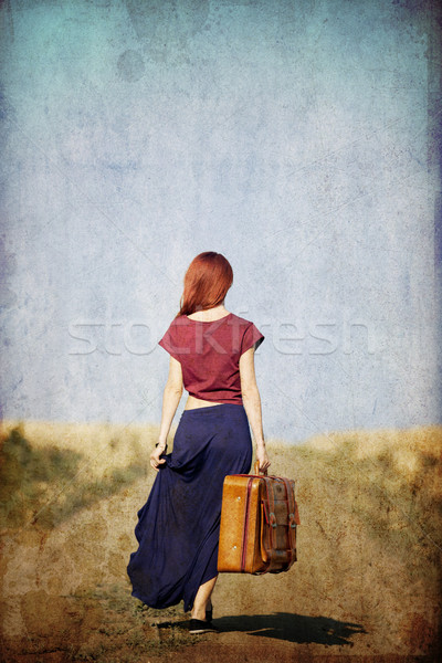 Redhead girl with suitcase at countryside road  Stock photo © Massonforstock