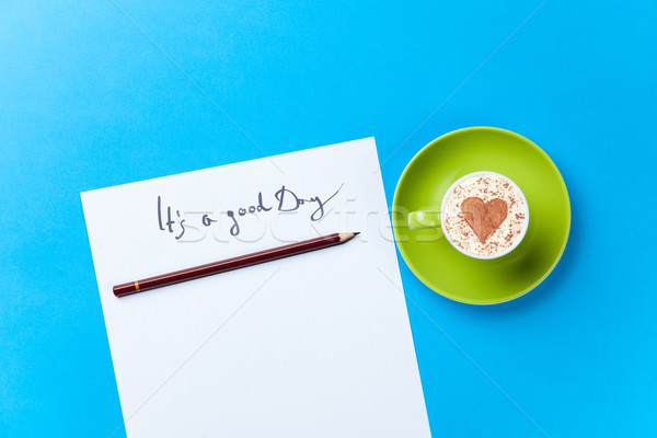 paper and cup lying on the table Stock photo © Massonforstock