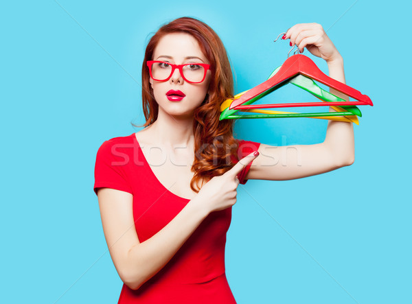photo of beautiful young woman with colorful hangers on the wond Stock photo © Massonforstock