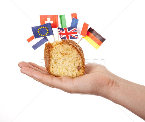 Hand keep cake with some european flags. Stock photo © Massonforstock
