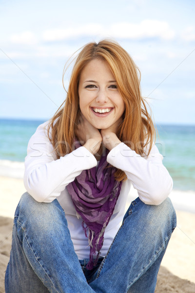 Young beautiful girl at the beach. Stock photo © Massonforstock