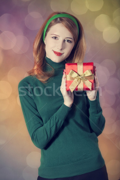 American redhead girl in sunglasses with gift. Photo in 60s styl Stock photo © Massonforstock