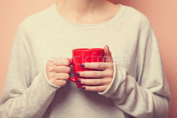 woman holding cup  Stock photo © Massonforstock