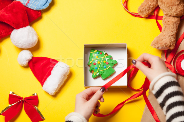 Woman wrapping gingerbread cookie Stock photo © Massonforstock