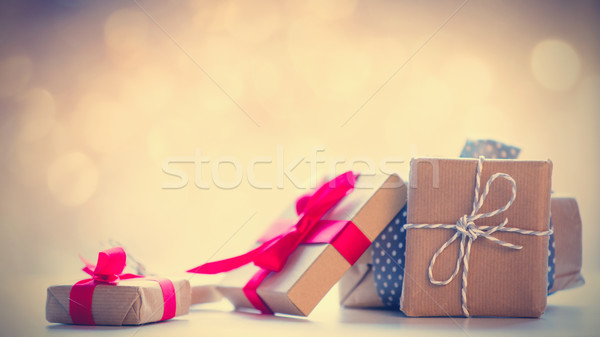 photo of beautiful colorful gifts on the fairy lights bokeh back Stock photo © Massonforstock