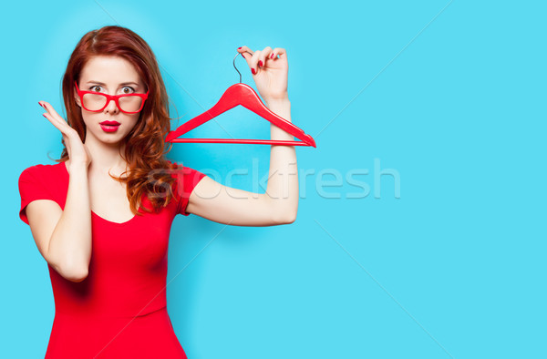 photo of beautiful young woman with hanger on the wonderful blue Stock photo © Massonforstock