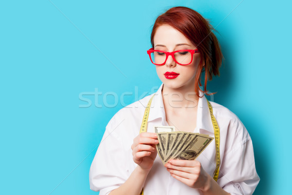 photo of beautiful young woman with money and centimeter on the  Stock photo © Massonforstock