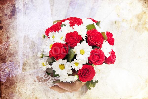 Bridegroom and bride holding beautiful red roses wedding flowers Stock photo © Massonforstock