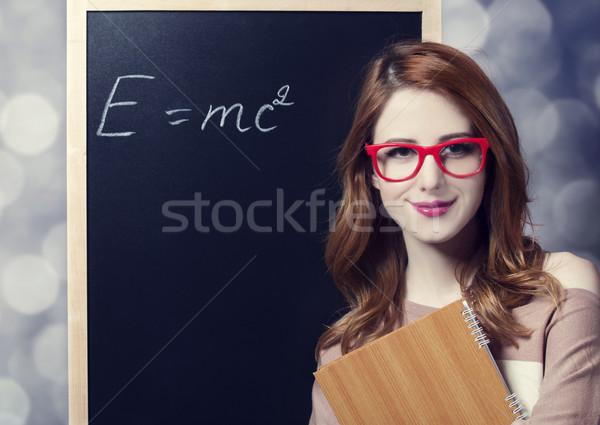 Redhead student near blackboard.  Stock photo © Massonforstock