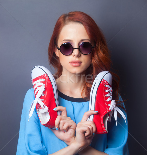 girl in blue dress with red gumshoes Stock photo © Massonforstock