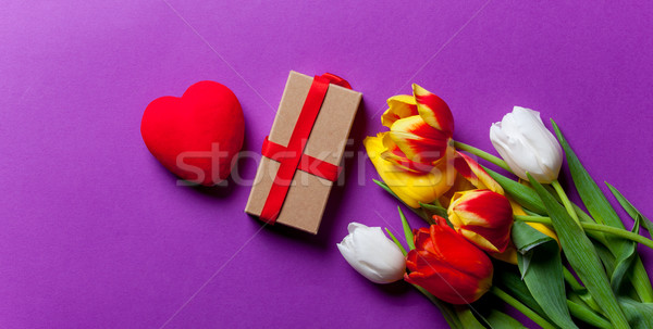 Beautiful bouquet of tulips and gift Stock photo © Massonforstock